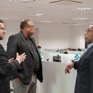 Com o Professor Natanael dos Santos e o assessor dele Davi, da Faculdade Zumbi dos Palmares, no atendimento ao público da DPU